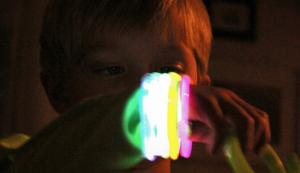 boy with glow sticks