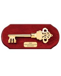 Gold Key On Cherry Wood Plaque